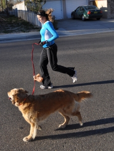 A pregnant me out for a run with the dog.